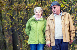 elderly couple going on a walk wearing jackets