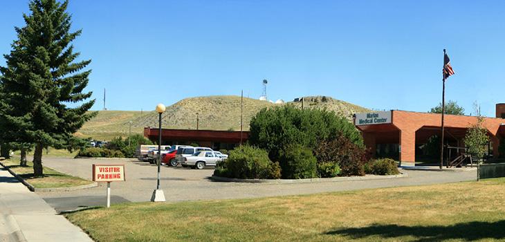visitor parking lot at facility