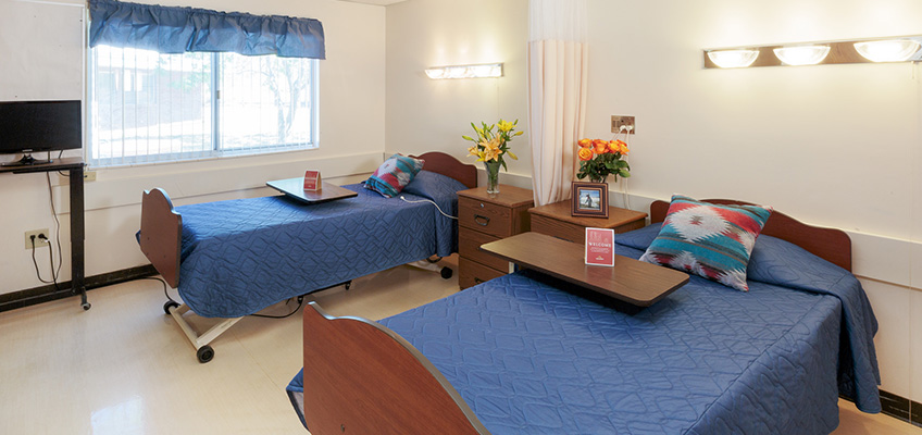 double occupancy resident bedroom with flowers on table
