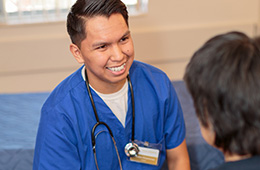 smiling male nurse with stethoscope