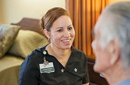 Nurse smiling at resident