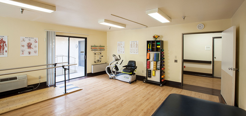 Clean rehab room with equipment