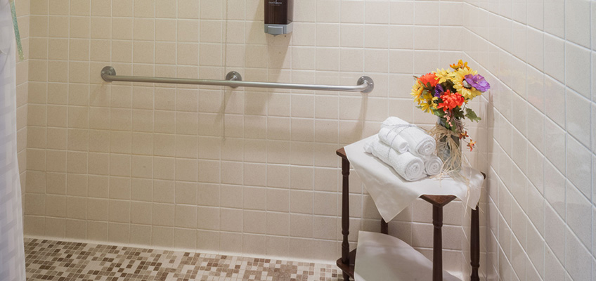 Resident shower with guard rails