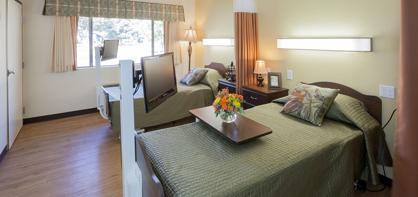 Dual occupancy rooms with personal televisions