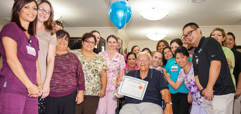 Resident awarded an award of excellence with the staff at Linwood