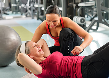 female resident working with a personal trainer