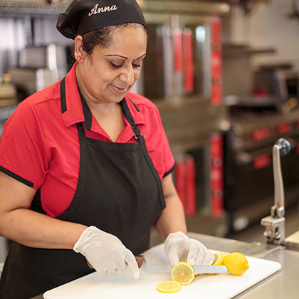 Chef cutting lemons in the kitchen