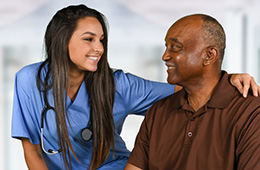 Nurse and resident smiling together