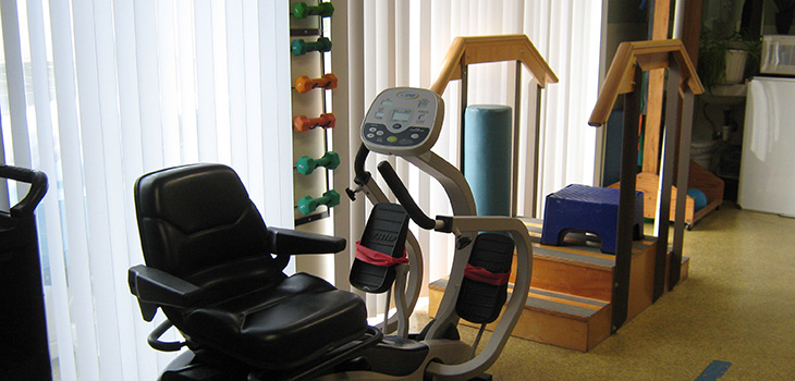 Rehabilitation room with organized equipment ready for use