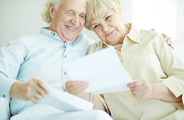 A couple sitting together looking at paperwork