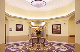 interior hallway with a centerpiece and chandelier