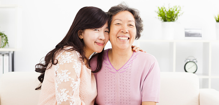 asian mother and daughter smiling