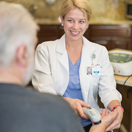 woman doctor checking heartbeat with technology
