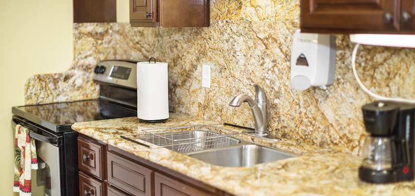 kitchen with clean tile, coffee maker and oven
