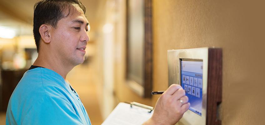 male nurse using wall technology