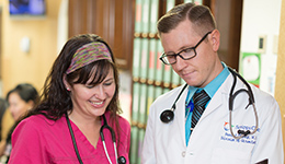 doctor and nurse working together smiling