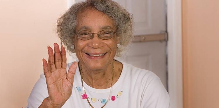 woman smiling and waving