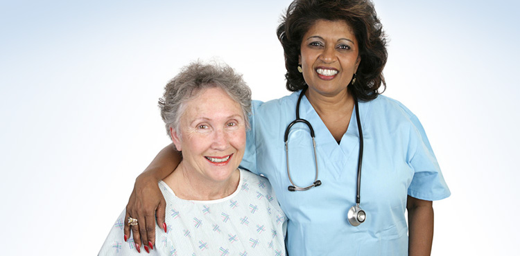 standing nurse and seated resident