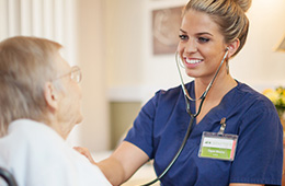 nurse using stethoscope on resident