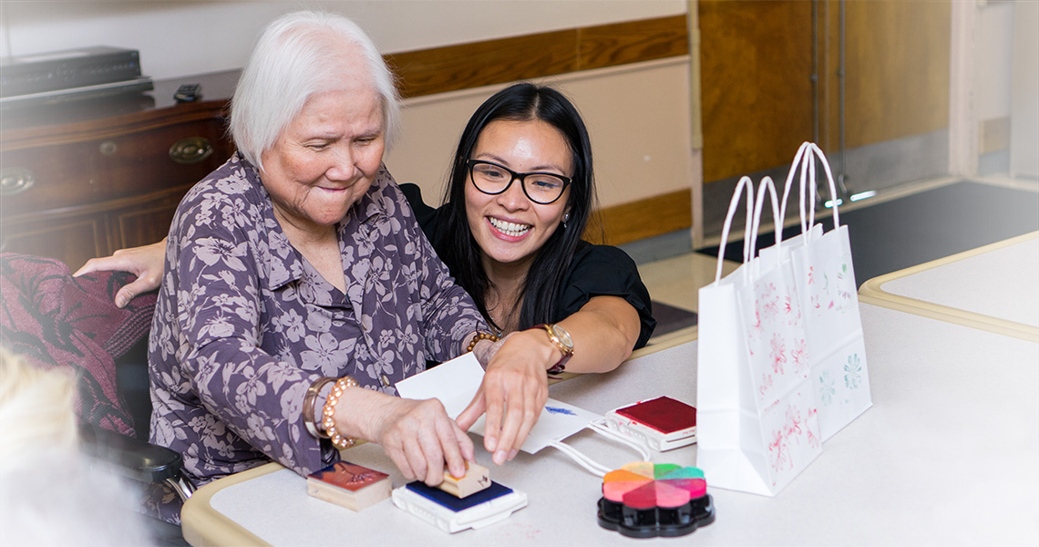 residents making home made gift bags for a craft project