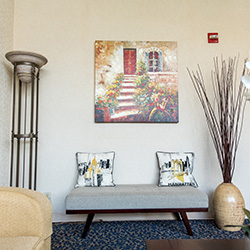 front entrance with comfortable seating and artwork on the walls