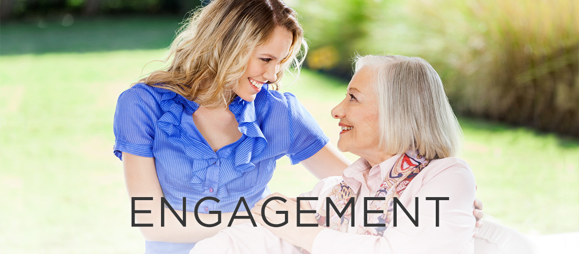 Woman smiling with the word engagement to the left