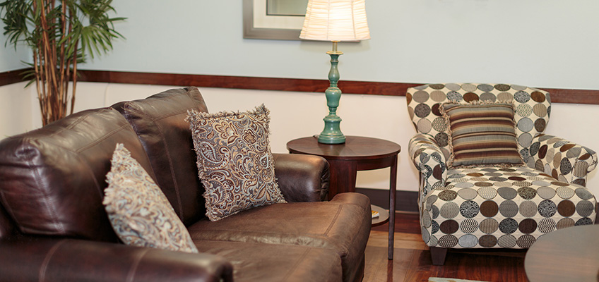 couch and chair in sitting area