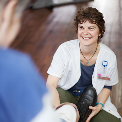 woman physical therapist helping patient