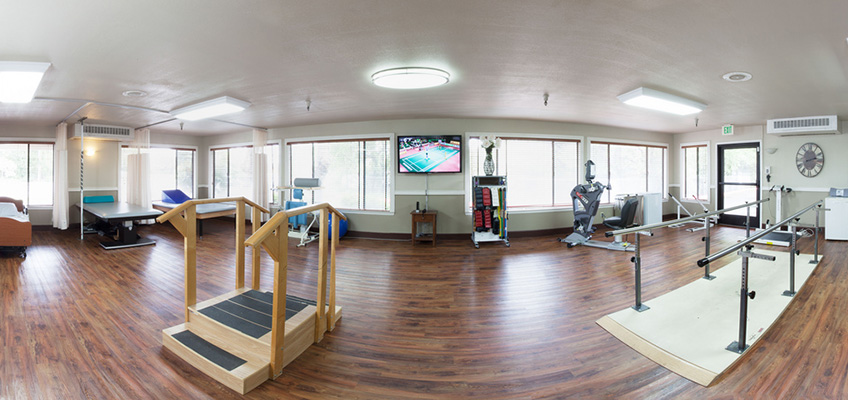 rehabilitation room with various equipment