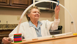 woman performing physical therapy with rings and poles