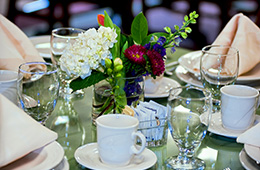 table setting with a flower centerpiece