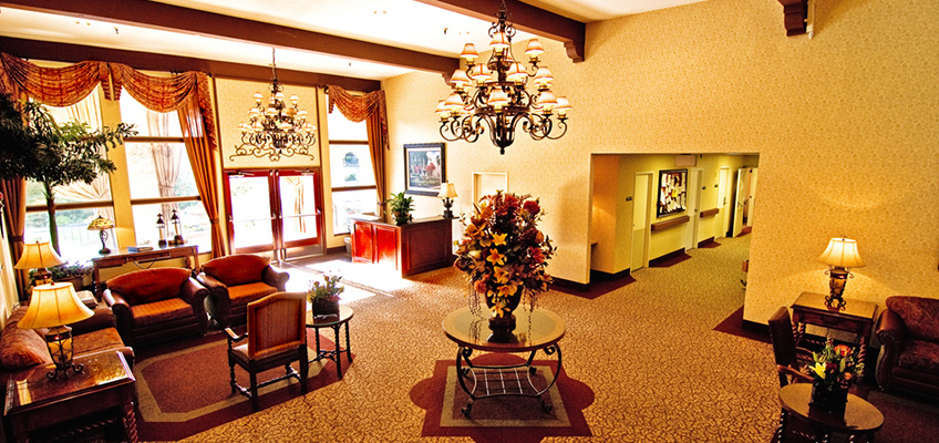 lobby area with chandeliers, carpeting and comfortable seating