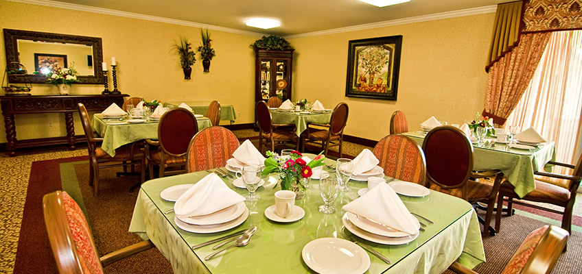 dining are with nice tableware and ornamental furniture and paintings