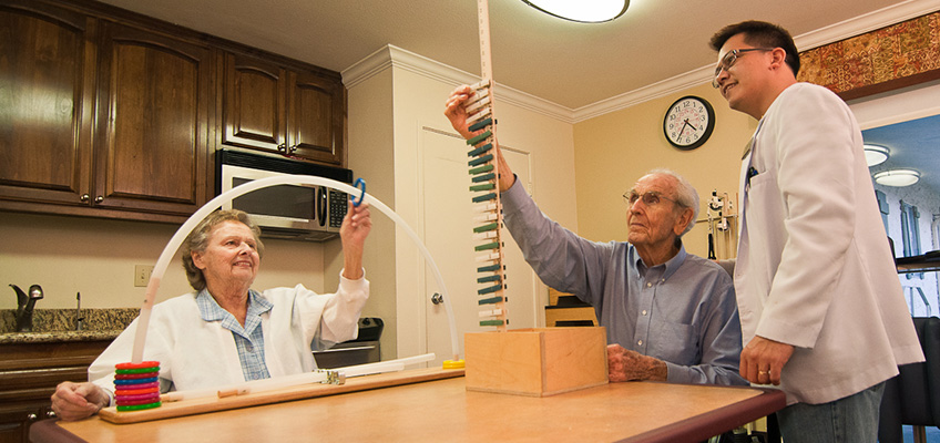 a elderly woman and man doing physical therapy