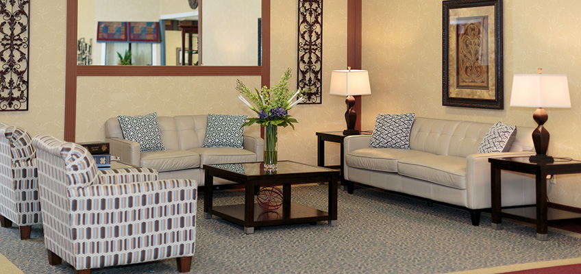 patterned chairs and sofas will pillows in the lobby
