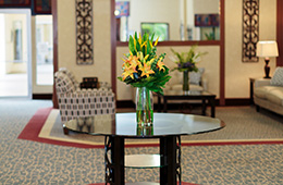 glass table with flowers on it in the lobby