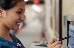 nurse using wall technology