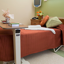 Resident room with nicely made bed