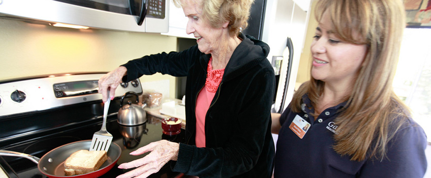 Rehab staff helping a resident make food