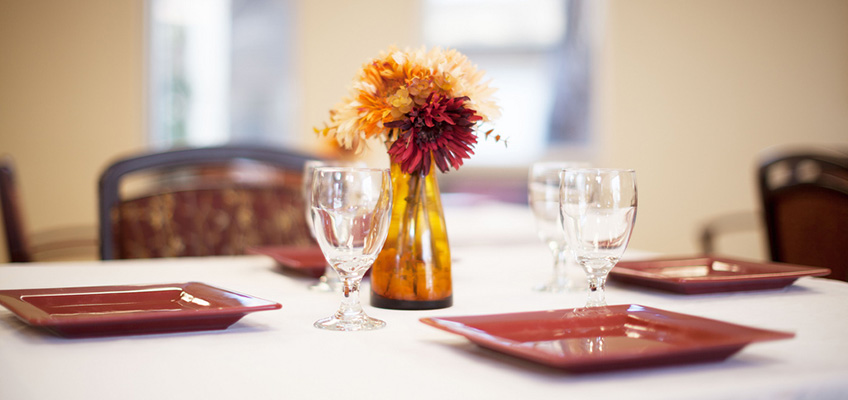 nice tableware and a flower centerpiece