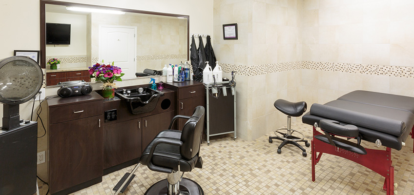 salon chair, sink, hair dryer and massage table