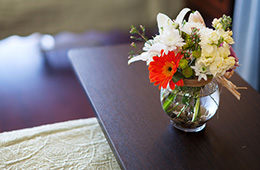 flowers sitting on a bedside table