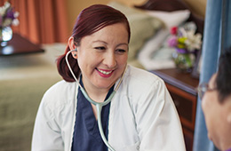 smiling doctor using a stethoscope