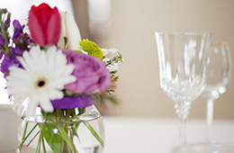 close up of flowers and nice glasses on a table