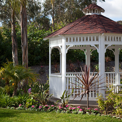 gazebo with nice plants and foliage surrounding it