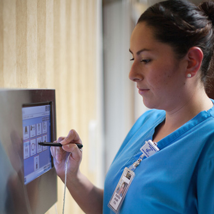 nurse using wall technology