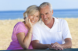 couple embracing and woman talking on cell phone
