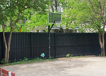 Outside area with basketball court and benches for relaxing