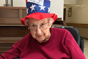 A resident with an American themed hat on