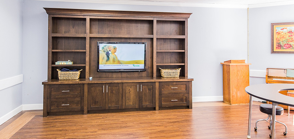 Pine Meadows entertainment center with flat screen TV